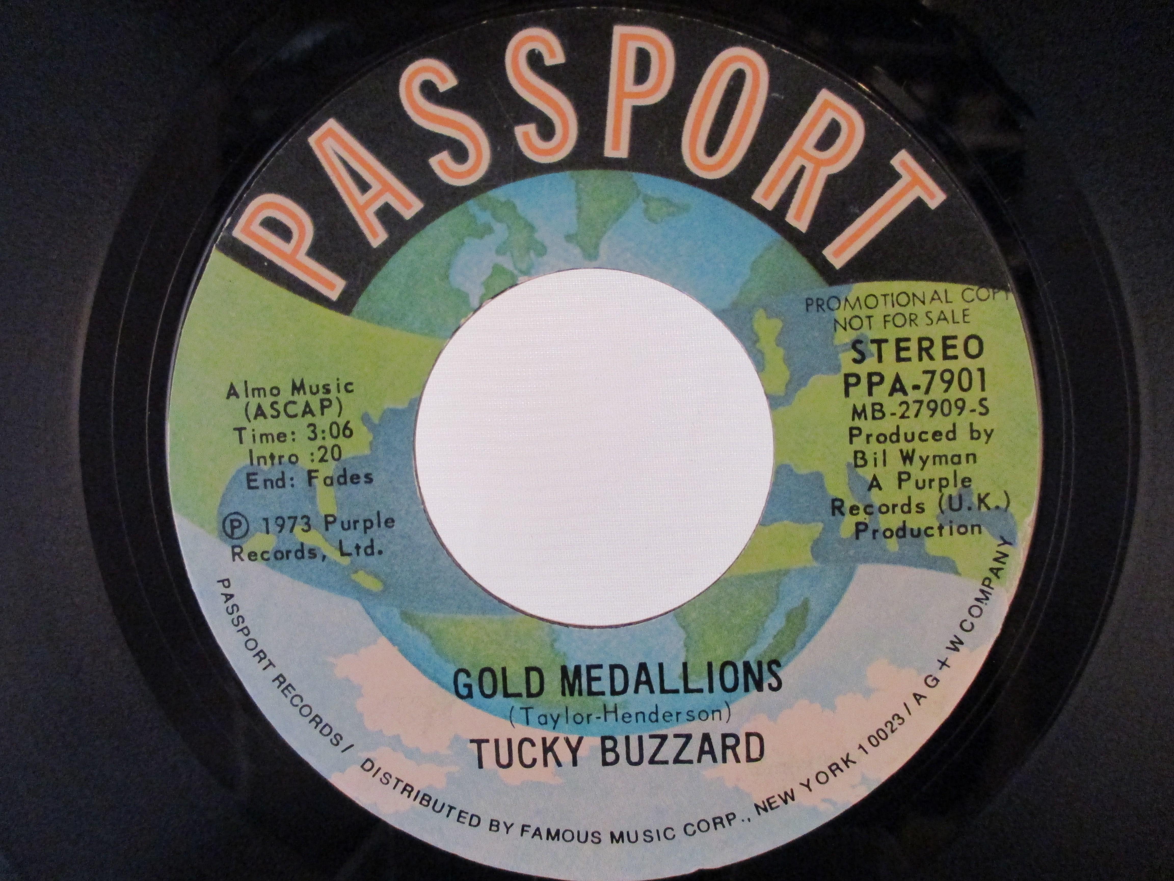 TUCKY BUZZARD : Gold medallions / - same
