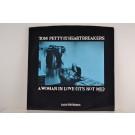TOM PETTY & HEARTBREAKERS : A woman in love (it's not me) / Gator on the lawn